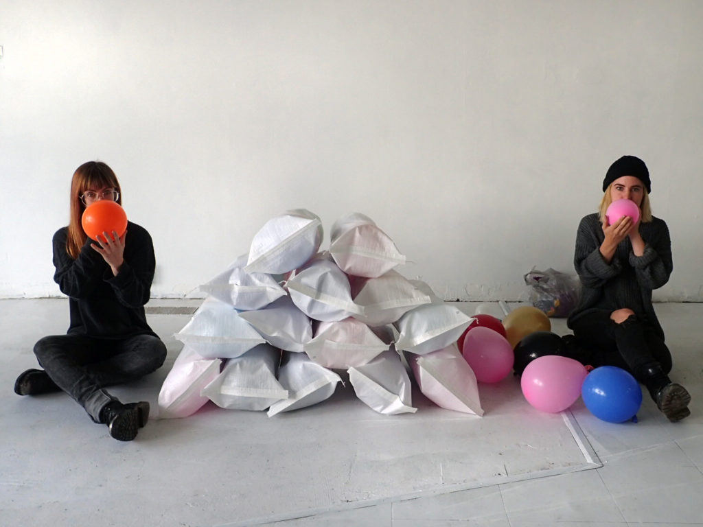September artists-in-residence, Rachel and Sarah Seburn, preparing for a performance piece at the Neighbourhood Time Exchange | Downtown Prince George Studio. Photo by Roanne Whitticase.